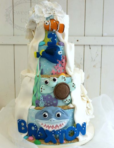 Ocean themed reveal wedding cake