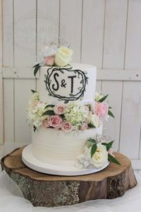 Rustic flower blocked wedding cake with monogram