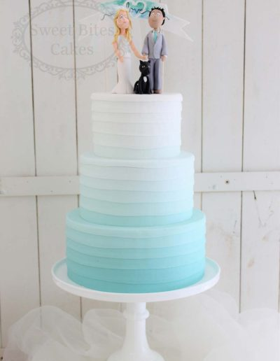 Ombre blue wedding cake with figurines
