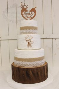 Etched fondant wedding cake with deers and hessian