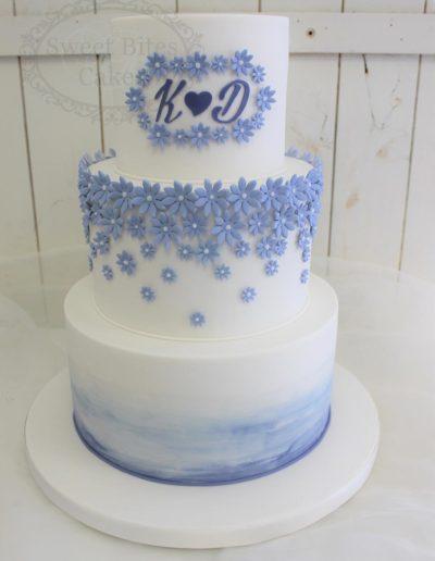 Purple blossoms wedding cake