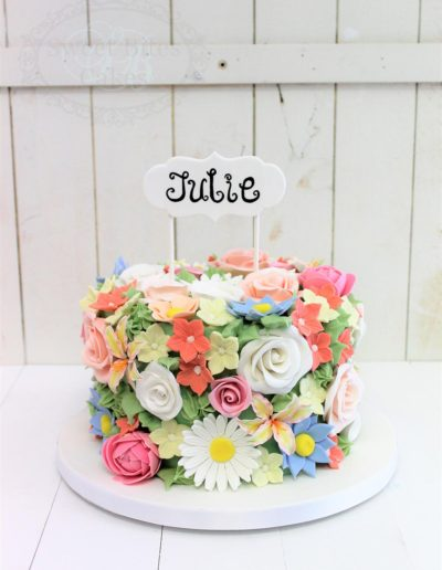 Sugar flower covered cake