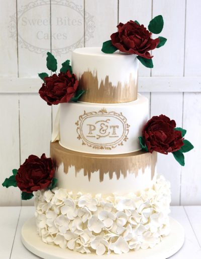 4 tier wedding cake with blossom ruffles and red peonies