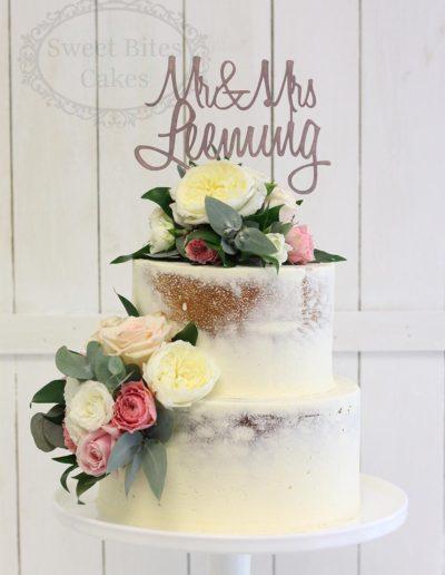 Semi naked ganache cake with fresh flowers