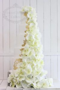 5 tier wedding cake with gold leaf and orchids
