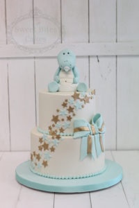Mint and gold dinosaur baby shower cake