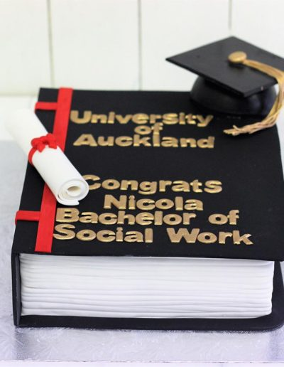 Graduation book cake with cap
