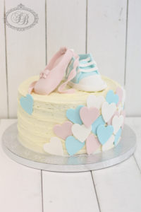 Hearts and shoes baby shower cake