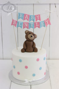 Bear and bunting baby shower cake
