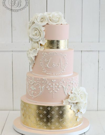 Pink and gold leaf 4 tier wedding cake with piping