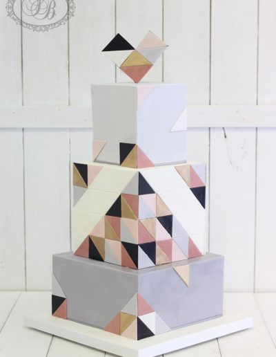 Square 3 tier wedding cake with geometric detailing