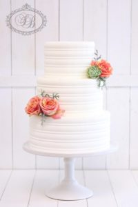 Royal icing wedding cake with simple flowers