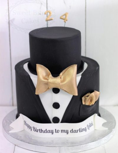 Black and gold suit jacket cake