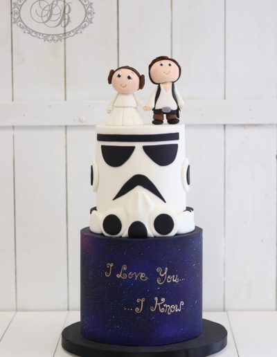 Star Wars themed wedding cake with character figurines