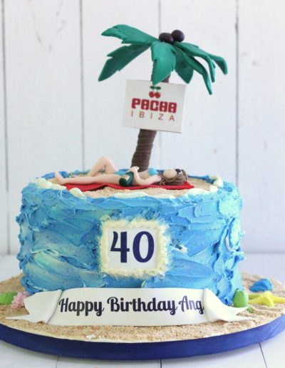 Buttercream beach scene cake with palm tree