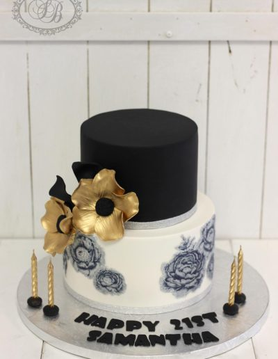 Black rose print cake with gold flowers