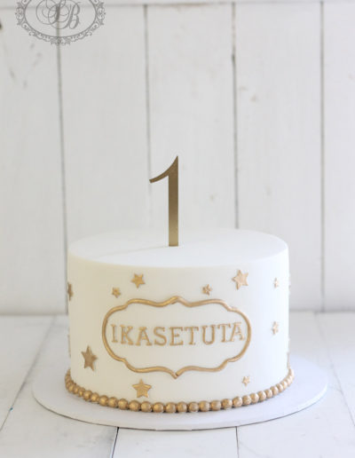 Simple gold and white 1st birthday cake