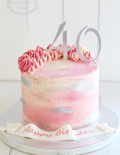 Pink and silver buttercream cake