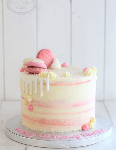 White drip cake with pink details