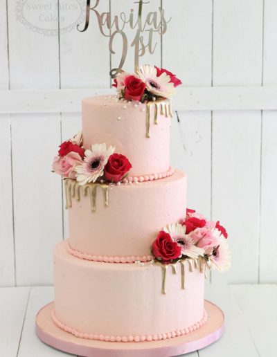 Smooth pink buttercream 3 tier cake