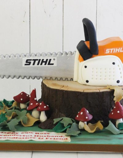 Woodland cake with 3D chainsaw