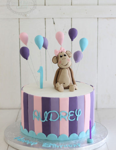 Purple stripes cake with balloons