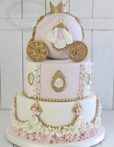 Cinderella carriage pink and gold cake