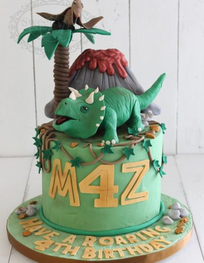 Dinosaur and volcano cake