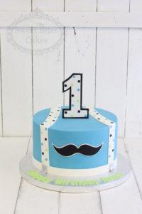 Blue moustache kids cake