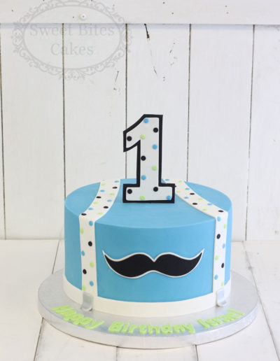 Blue moustache kids cake
