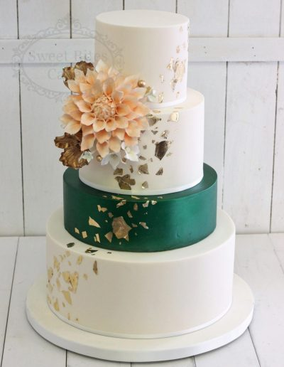 White and emerald wedding cake with gold leaf