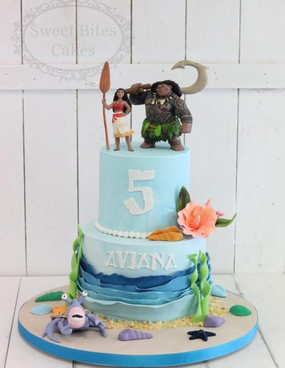 2 tier Moana and maui cake