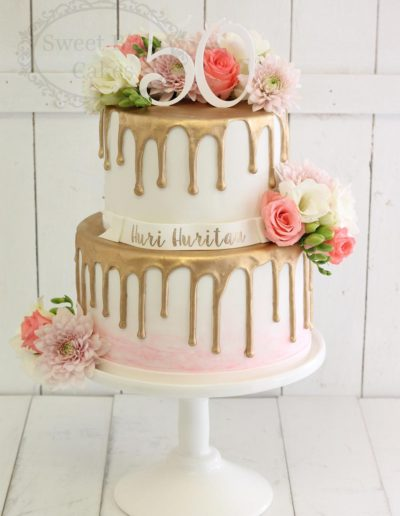 Gold drip cake with flowers