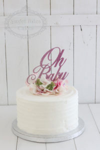 White royal icing baby shower cake