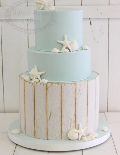Beach themed wedding cake with seashells
