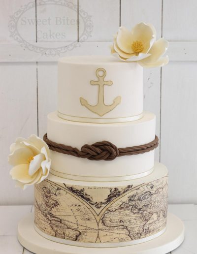 Nautical themed wedding cake with world map