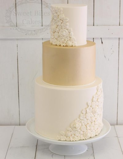 Champagne and ivory wedding cake with 2D flowers