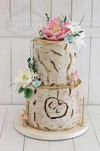Log effect cake with sugar flowers and mushrooms