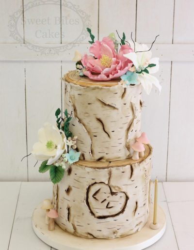 Log effect cake with sugar flowers