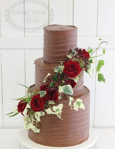 Chocolate ganache finish wedding cake with red roses