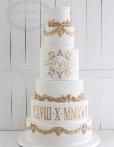 Regal gold and white 6 tier wedding cake