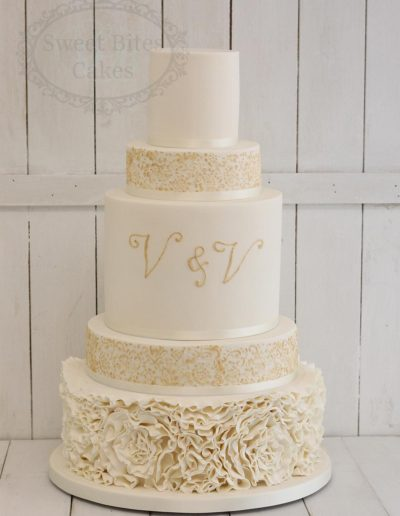 Ivory and gold ruffle wedding cake