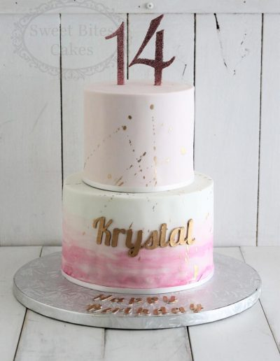 2 tier 14th birthday cake with gold splatter