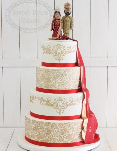 Detailed gold piped cake with sari drape