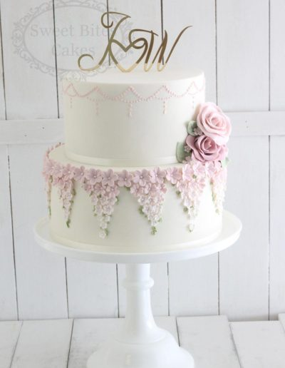 2 tier wedding cake with soft pink blossoms