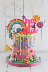 Colourful candy overload and rainbow cake