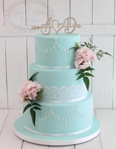 Mint wedding cake with pearl piping