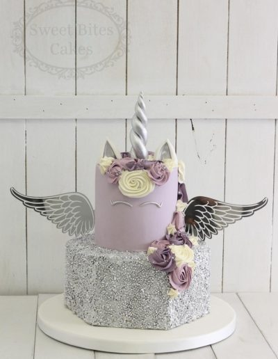 Purple unicorn and angel wings cake