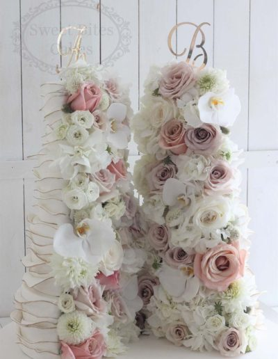 Cross sectioned wedding cake with fresh flowers