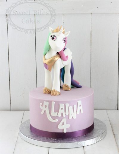 Purple unicorn figurine cake